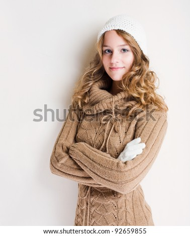 Beautiful confident young blond woman in fashionable winter outfit. - stock photo