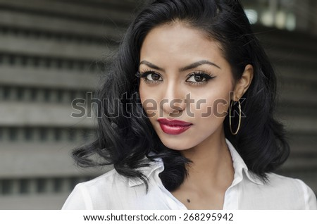 Beautiful confident young woman - stock photo