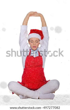 beautiful cook in Santa hat with snow on white background