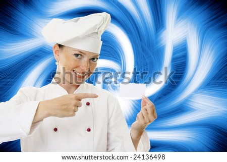 Beautiful cook woman holding blank card over a abstract background - stock photo