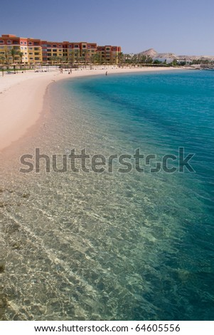 Beautiful coral reef in turquoise clear water of the Red Sea near Hurghada, Egypt - stock photo