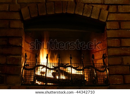 Beautiful cosy brick-built fireplace - stock photo