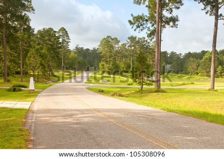 Beautiful country roads in rural Florida residential community. - stock photo