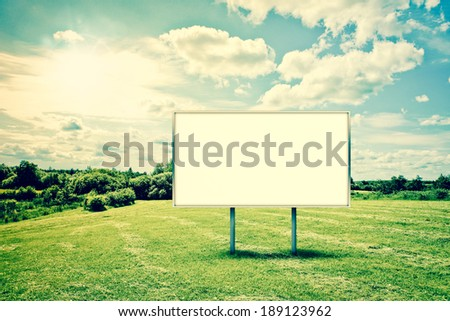 Beautiful countryside landscape with a billboard sign - stock photo