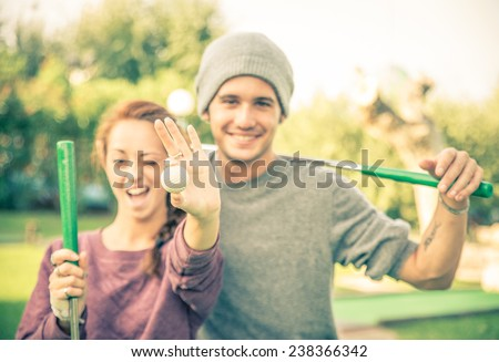 Beautiful couple at the golf club  - stock photo