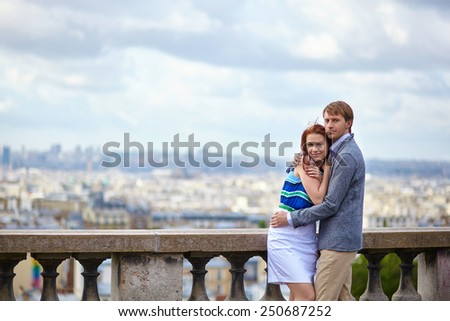 Beautiful couple at viewpoint on Montmartre in Paris - stock photo