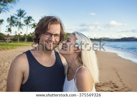 Beautiful couple enjoying an exotic island honeymoon together - stock photo
