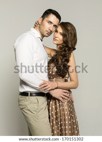Beautiful couple hugging each other - stock photo