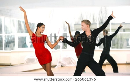 Beautiful couple in active ballroom dance, indoors - stock photo