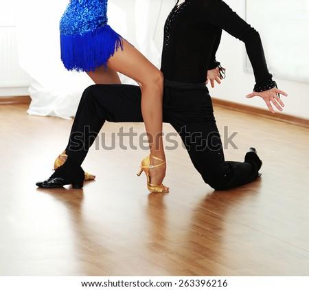 Beautiful couple in ballroom dance - stock photo