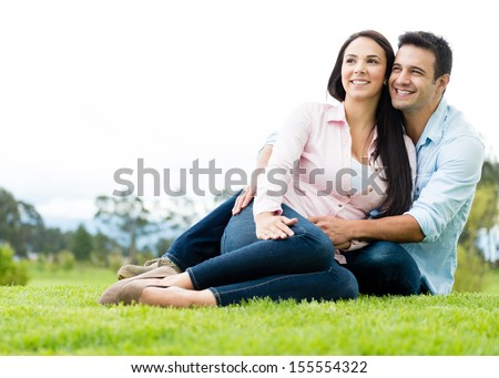 Beautiful couple in love looking very happy  - stock photo