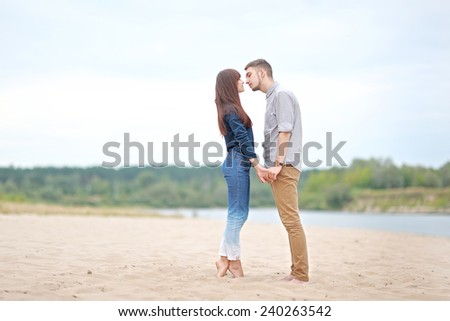 beautiful Couple in love on summer beach - stock photo