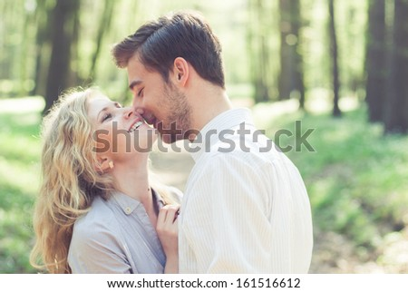beautiful couple in love. photos in gentle tones - stock photo