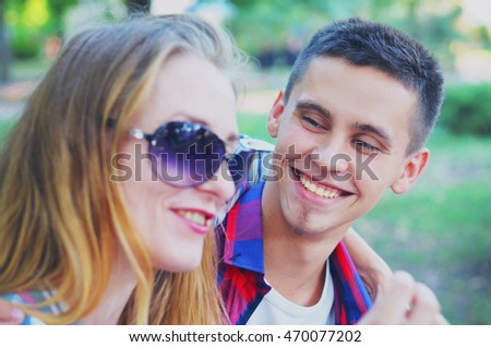 Beautiful couple in love woman and man laughing and talking cheerfully.