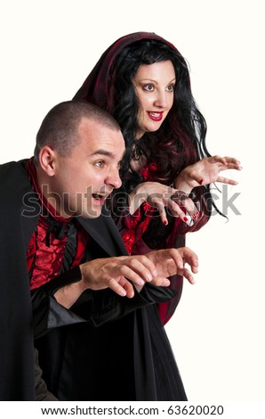 Beautiful couple in medieval vampire costumes, studio shot isolated on white - stock photo