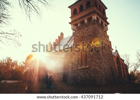 beautiful couple in  sunset time in a castle - stock photo