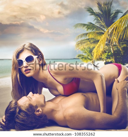 Beautiful couple in swimsuit at the seaside - stock photo