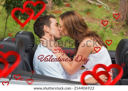 Beautiful couple kissing in back seat against cute valentines message - stock photo