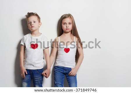 beautiful couple. little girl and boy holding hands.funny kids - stock photo