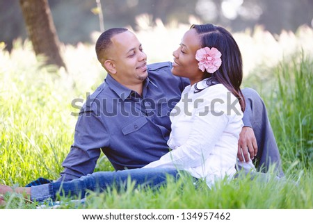 Beautiful couple looking into each other's eyes lovingly - stock photo