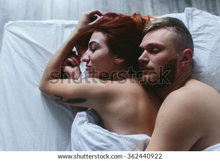 beautiful couple lying together on the bed