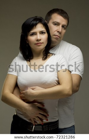 Beautiful couple - man embracing woman