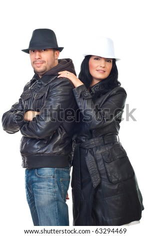 Beautiful couple of models in leather jackets and hats isolated on white background