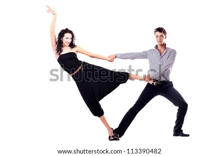Beautiful couple of professional artists dancing passionate dance. Isolated over white.