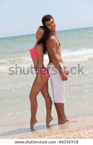 beautiful couple posing on the sea beach