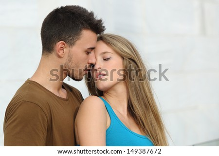 Beautiful couple ready to kiss with love and passion outside - stock photo