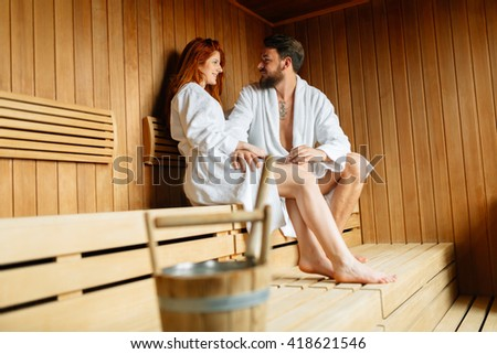 Beautiful couple relaxing in sauna and caring about health and skin - stock photo