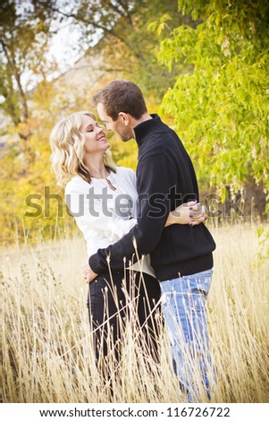 Beautiful Couple Sharing a Kiss - stock photo