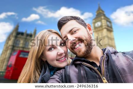 Beautiful Couple taking a selfie photo in London, England - stock photo