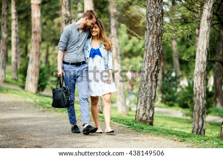 Beautiful couple taking a walk in  city park - stock photo