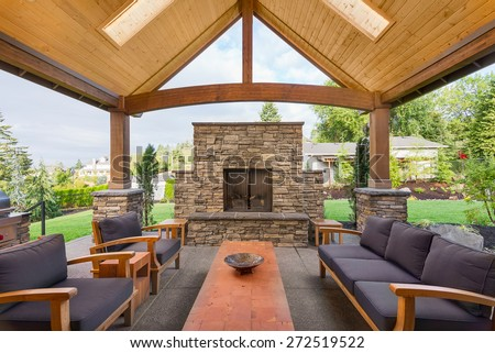 Beautiful Covered Patio Outside New Luxury Home - stock photo