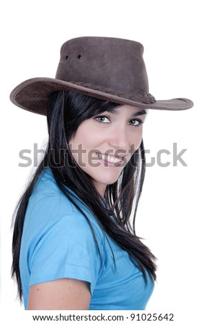 Beautiful cowgirl wearing hat isolated on white background - stock photo