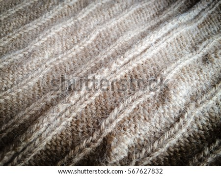 Beautiful crafted gray wool knitted background, natural soft surface