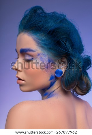 beautiful creative makeup, blue art, a beautiful girl model - stock photo