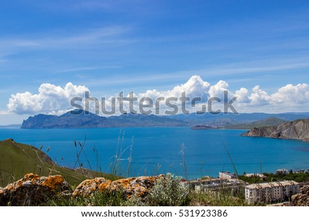 Beautiful crimean seascape: mountains, sky, blue sea. Ordjonikidze town