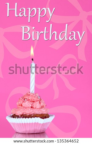 Beautiful cupcake with candle on pink background - stock photo