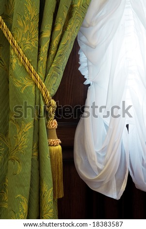 Beautiful curtains with an ornament in a luxury apartment - stock photo