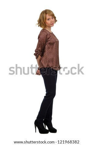 Beautiful curvy demure young blonde woman in a stylish outfit with high heeled shoes posing sideways , full length studio portrait isolated on white - stock photo