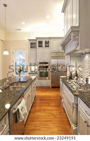 beautiful custom kitchen with granite and glass tile - stock photo