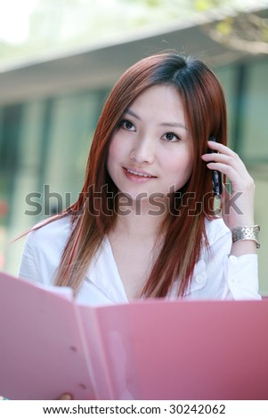 Beautiful Customer Representative holding with folder