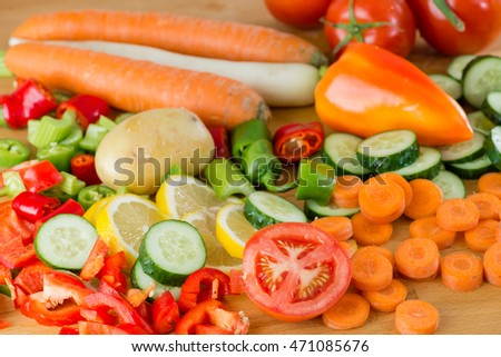 beautiful cut vegetables on a wooden board in the kitchen