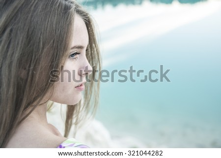 Beautiful cute Woman. Close Up Portrait. Beauty young adult sad girl look at war away. Female think about something and enjoying on  beach coast. Empty copy space for inscription White and black - stock photo