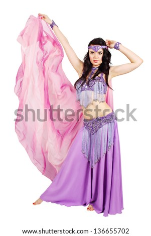 Beautiful dancer in eastern costume with scarf - stock photo