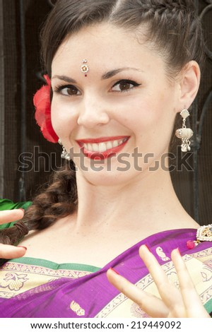 Beautiful dancer in Indian traditional dress - stock photo