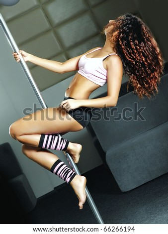 beautiful dancer on the pole - stock photo