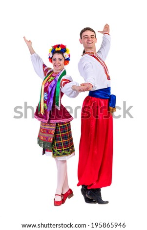 beautiful dancing couple in ukrainian polish national traditional costume clothes happy smile, full length portrait isolated over white background - stock photo